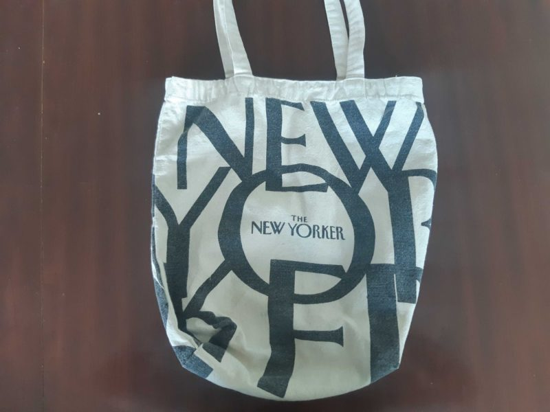 Man delighted to discover his New Yorker tote bag is the perfect size to keep his stack of unread New Yorkers - The Beaverton